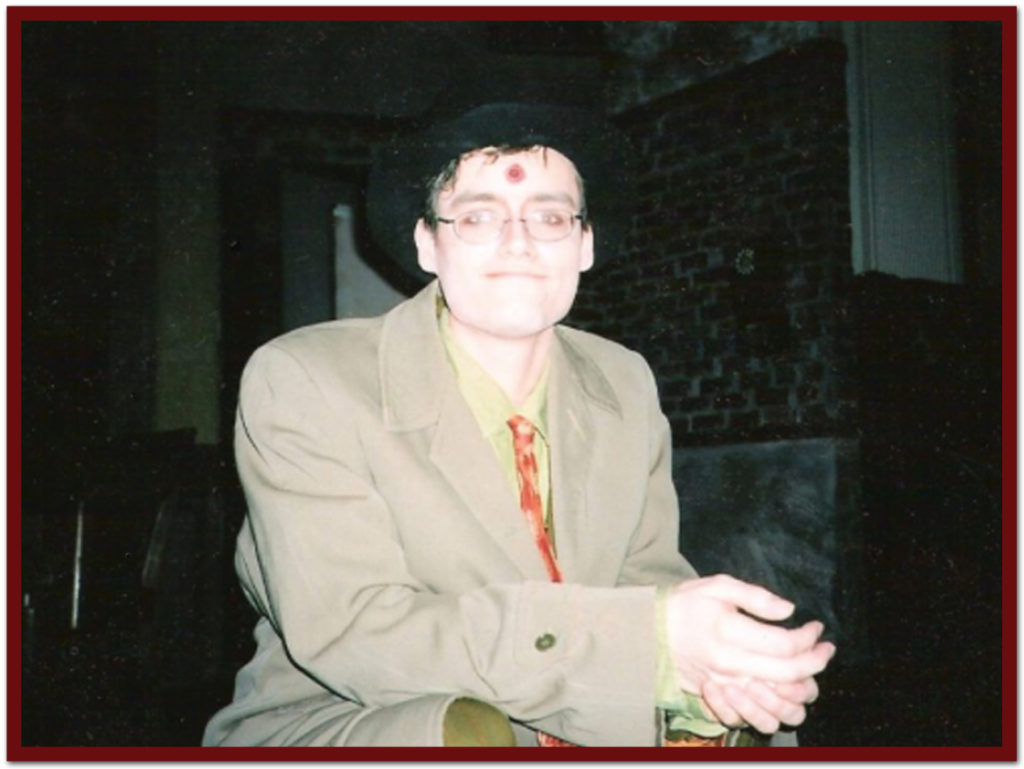 Chris was fatally shot in the play. Note bullet hole in forehead.