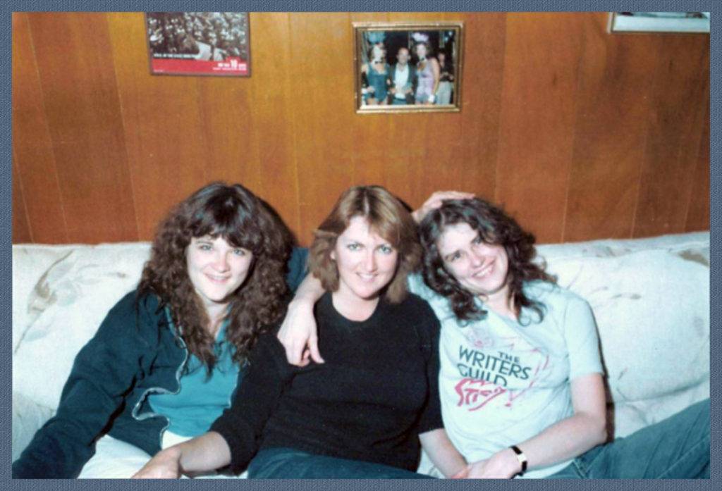W/my sisters, wearing my Writer's Guild Strikes! tee-shirt. The WGA struck for the right to determine their own credits - and it was worth it.