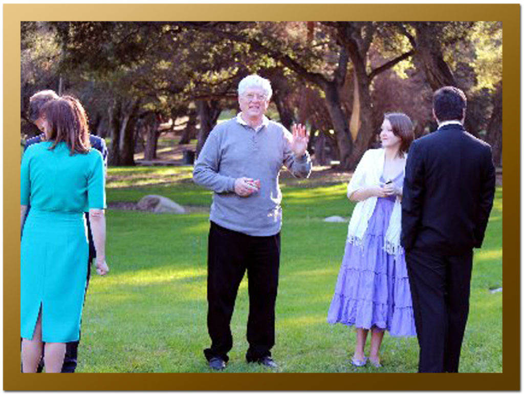 Bill Connell directing traffic (center) before the wedding - Carly Salter Govind in purple to his right.
