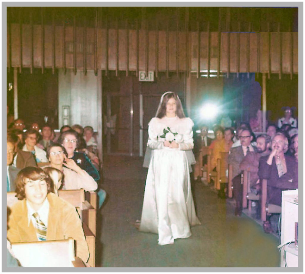 Joyce enters wearing my mother's original wedding dress