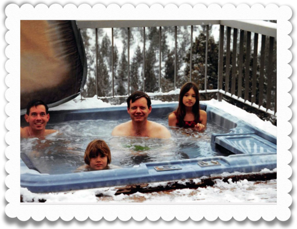 Matt, Alex, John and Sam in outdoor hot tub in the snow.