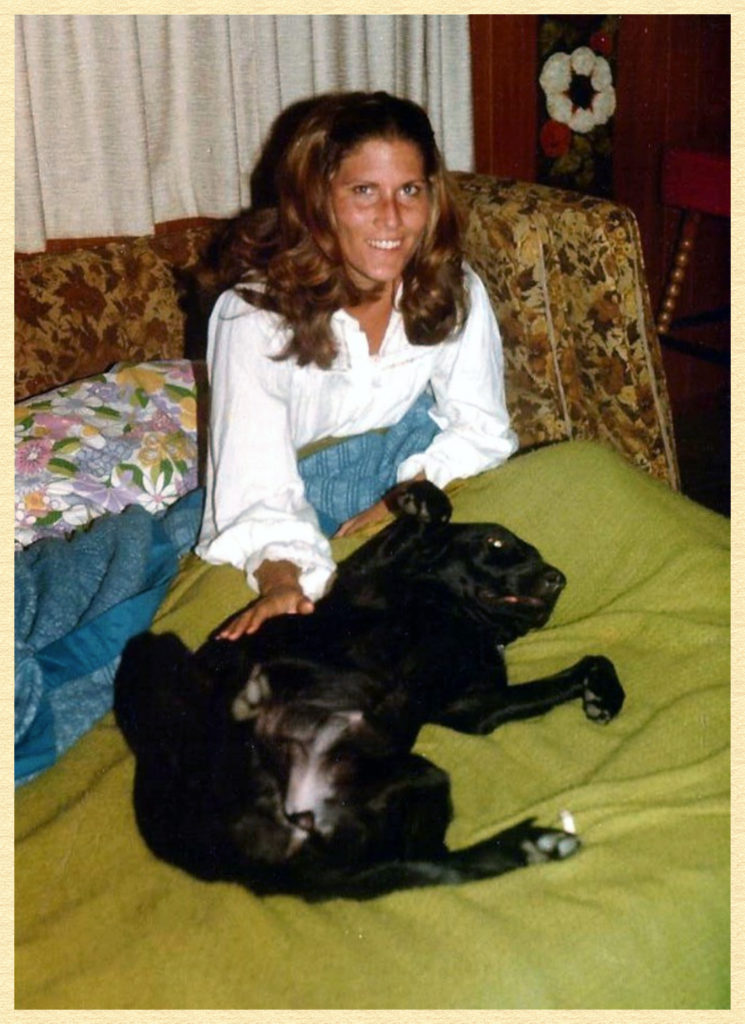 Anne with our first dog, a black lab named Greta.