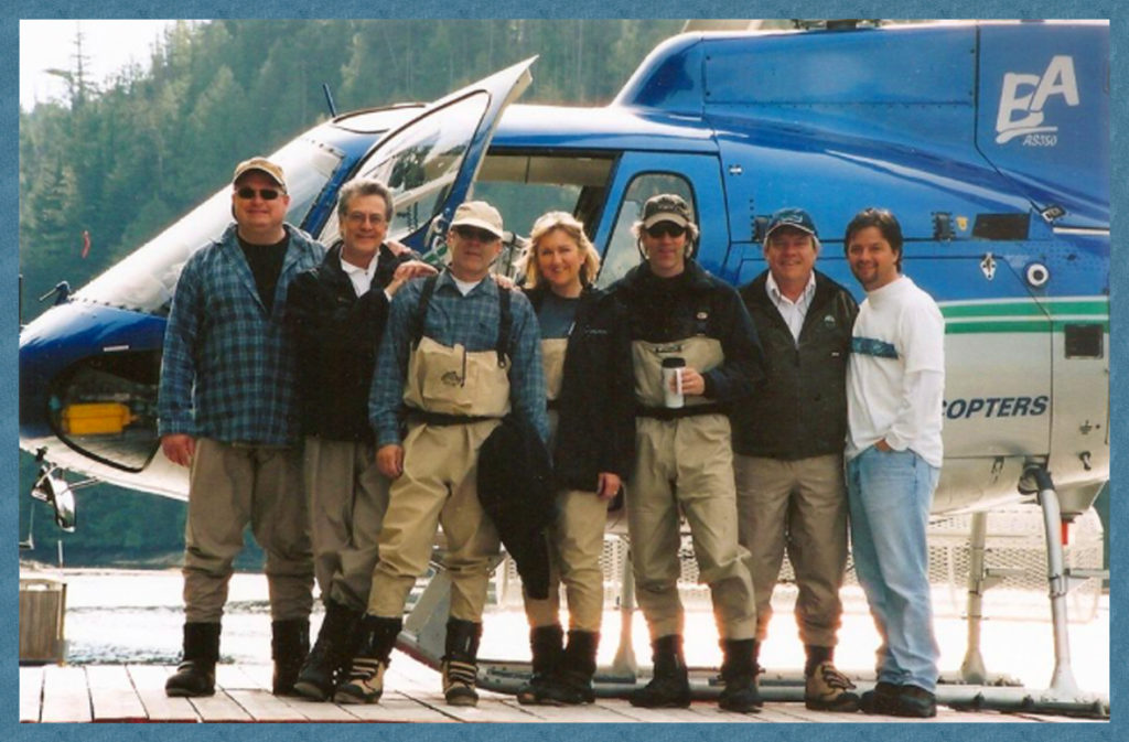 Janet and Boston Legal producers standing in front of the helicopter that ferried them over glaciers to shooting location in Nimmo Bay, Canada.