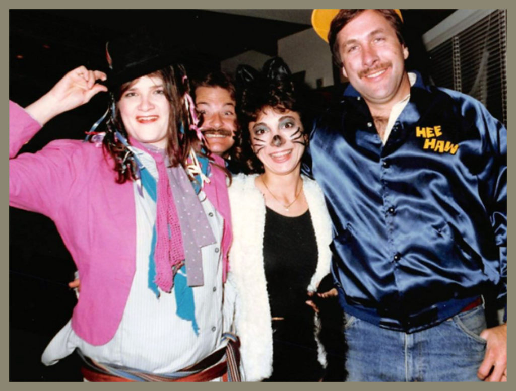 Jake pops his head into photo with Joyce Salter, Patti Akopianz Cavender and Randy Cavender (a Halloweeen party)
