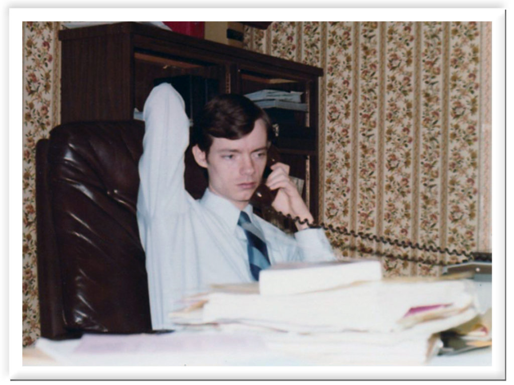 John in young workaholic lawyer mode