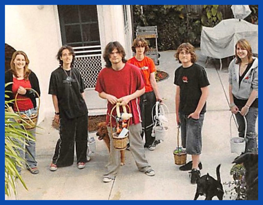 Kids and dogs in McCann backyard. Before or since, Alex has NEVER had such long hair.