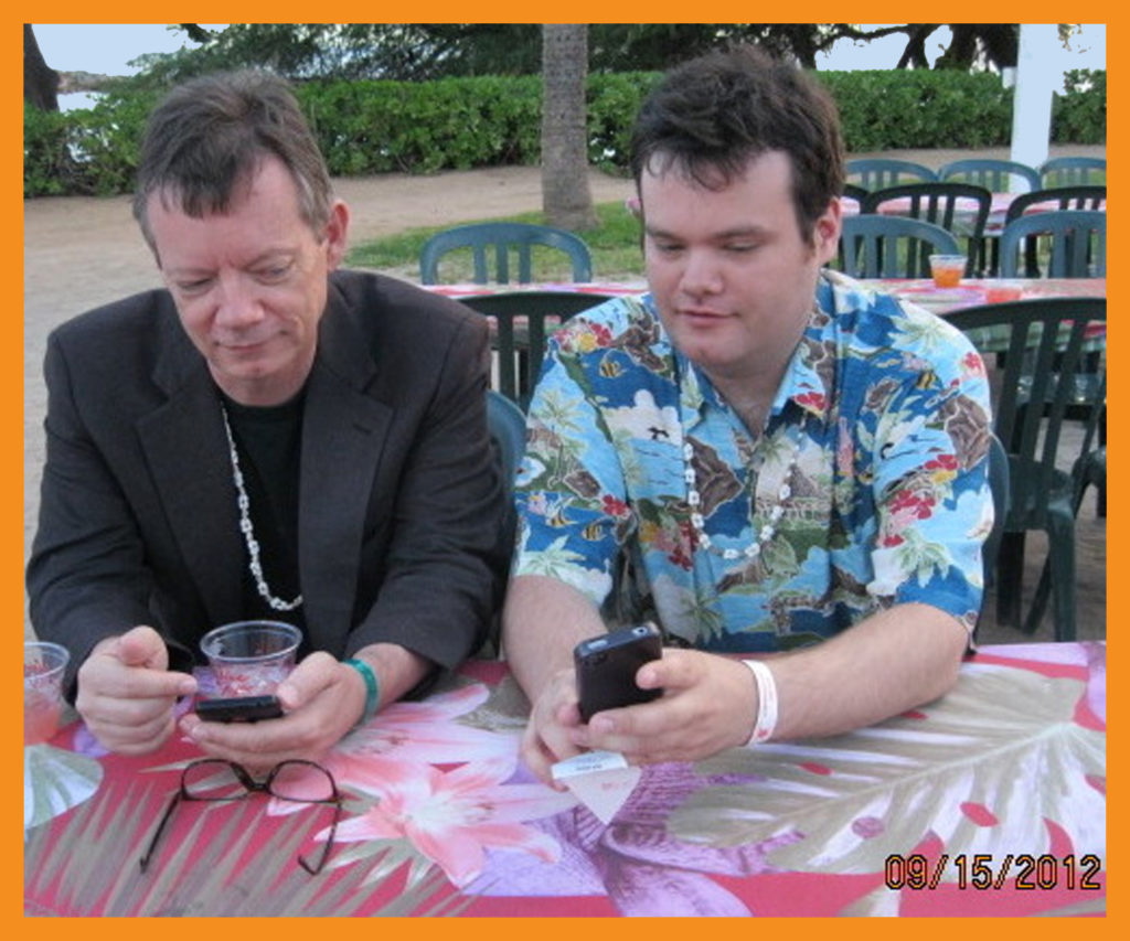 John and Alex check cell phones to take care of business (at Luau).