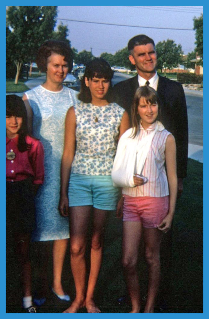 Me slightly sulky with family in 1966