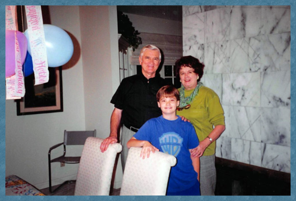 Birthday boy with his grandparents.