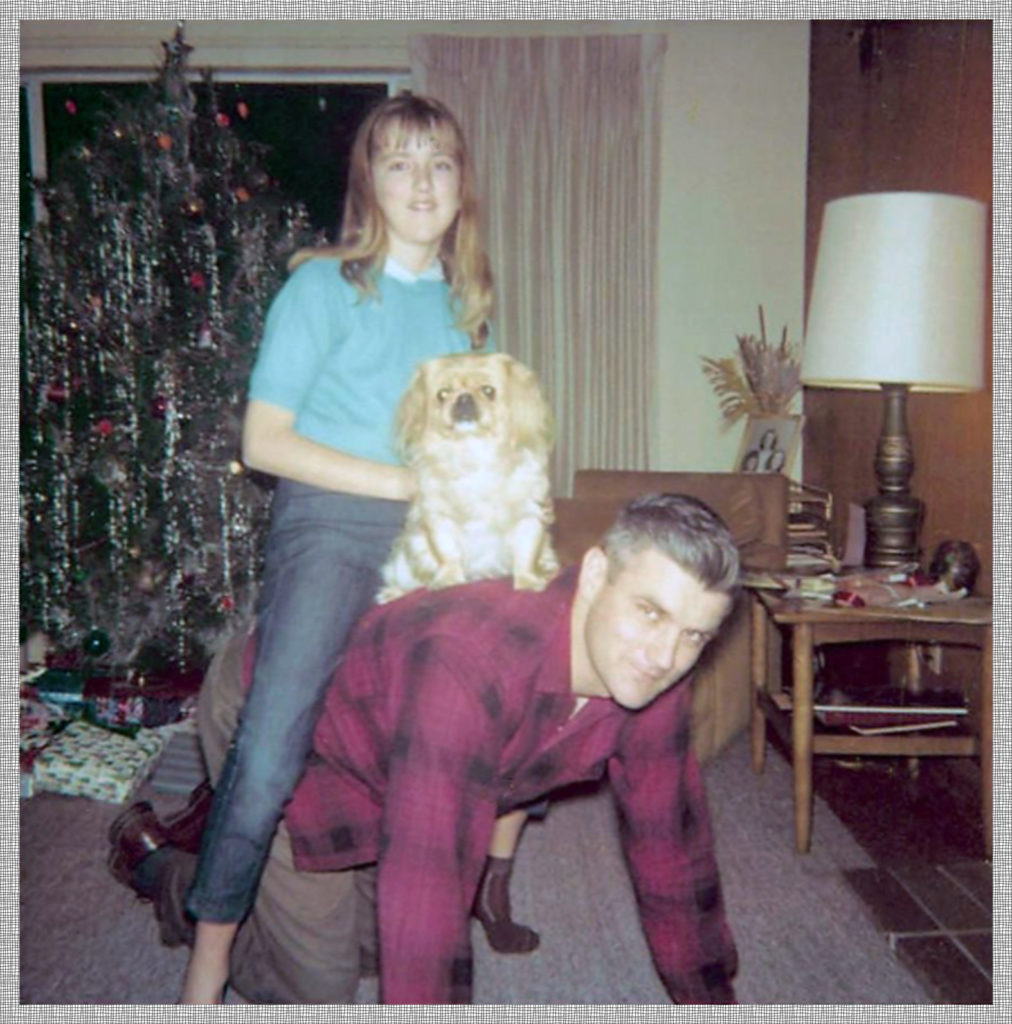 My dad giving sister Janet a horsy ride on what was probably a family night.