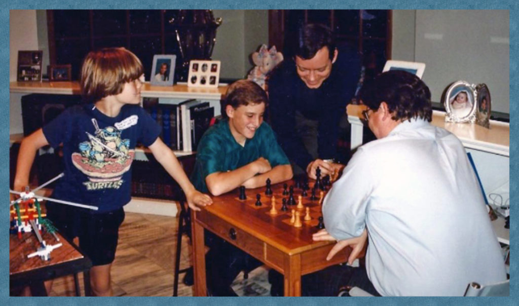 John and Michael challenge Jimmy at chess.