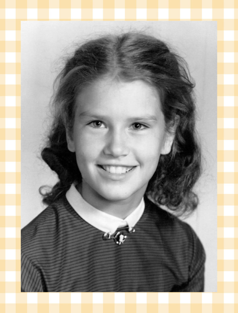 School picture of a girl desperate to be teacher's pet.
