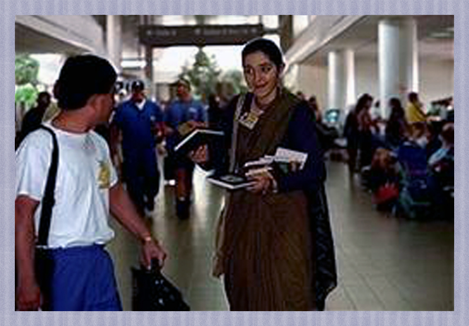 Krishna girl selling book at LAX
